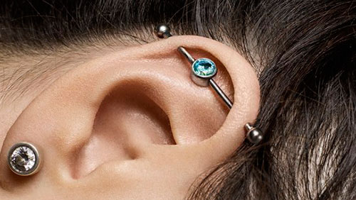 прокол уха индастриал