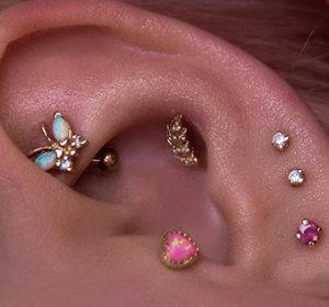 Серьги для пирсинга хряща уха: виды украшений и материалов